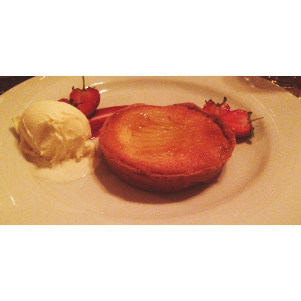 Pear Frangipane Tart, Raspberry coulis, vanilla ice cream